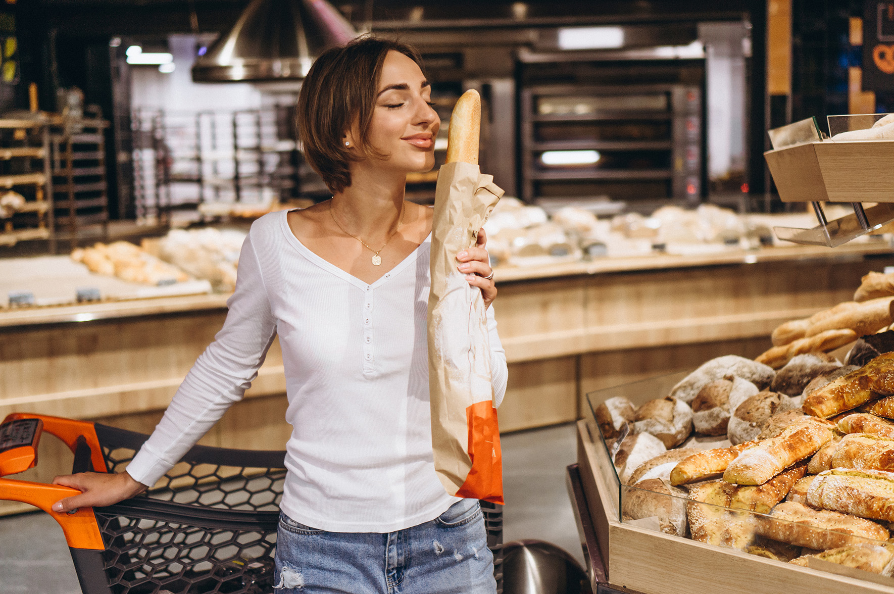 Woman at the grocery store buying fresh bread